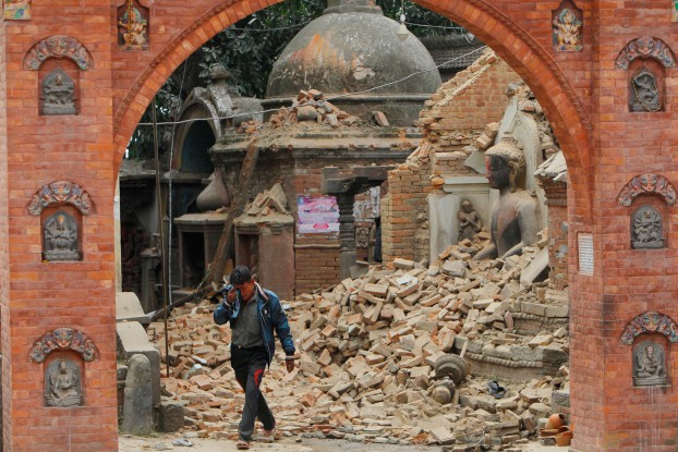 A Nepalese man cries as he walks through the earthquake debris in Bhaktapur, near Kathmandu, Nepal, Sunday, April 26, 2015. A strong magnitude 7.8 earthquake shook Nepal's capital and the densely populated Kathmandu Valley before noon Saturday, causing extensive damage with toppled walls and collapsed buildings, officials said. (AP Photo/Niranjan Shrestha)