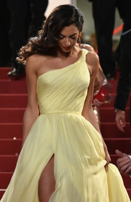 """British-Lebanese lawyer Amal Clooney leaves on May 12, 2016 the Festival Palace after the screening of the film """"Money Monster"""" at the 69th Cannes Film Festival in Cannes, southern France. / AFP PHOTO / ALBERTO PIZZOLI"""